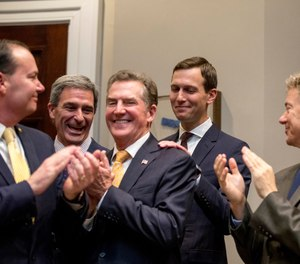 """President Donald Trump's White House Senior Adviser Jared Kushner, second from right, smiles as Sen. Mike Lee, R-Utah, left, former Virginia Attorney General Ken Cuccinelli, second from left, former Sen. Jim DeMint of the Heritage Foundation, third from left, and Sen. Rand Paul, R-Ky., right, applaud as President Donald Trump recognizes Kushner as he speaks about H. R. 5682, the """"First Step Act"""" in the Roosevelt Room of the White House in Washington, Wednesday, Nov. 14, 2018, which would reform America's criminal justice system. (AP Photo/Andrew Harnik)"""