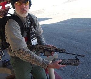 PoliceOne Editor in Chief Doug Wyllie tests the P320, the MPX, and the MCX at Range Day with SIG SAUER. (PoliceOne Image)