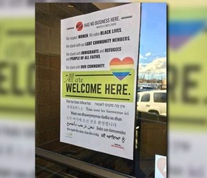 "Chief Brian Schaeffer was heavily criticized for posting a sign stating ""All are welcome here"" on the front door of every fire station in the city. (Photo/KREM)"