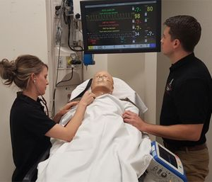 EMS students practice airway management and respiratory care with a high-fidelity patient simulator. (Photo/Aaron Dix)