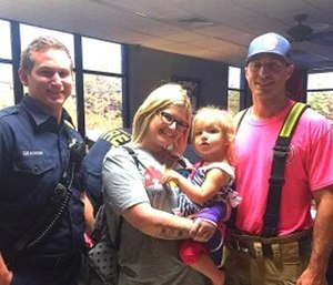 "A mother expressed her gratitude to firefighters for calming her autistic daughter by singing ""Wheels on the Bus"" after a car crash last month. (Photo courtesy MyAtlantaMomsClub.com)"