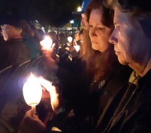 Sisters Starr Sidelinker and Rhoda Hembd have been to 13 Police Week services to honor the memory of their brother, Harley Alfred Chisholm, who was ambushed and murdered along with two fellow officers in 2004. (Photo/Joel Shults)