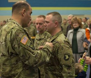 Staff Sgt. Nicholas Davis finished rescuing Rick and Sharon Steiert from a burning vehicle despite catching on fire himself. (Photo/U.S. Army)