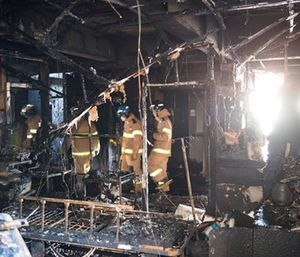 Firefighters inspect a burnt hospital after a fire in Miryang, South Korea. (Jeon Mincheol/Kookje Shinmun via AP)