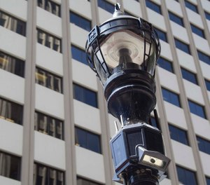 """A """"smart"""" streetlamp that includes an array of sensors including video and audio in downtown San Diego. The module below the traditional light houses cameras, antennas and other monitoring instruments. (John Gibbins/The San Diego Union-Tribune/TNS)"""