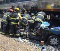 Firefighters rescue woman, child from train vs car crash