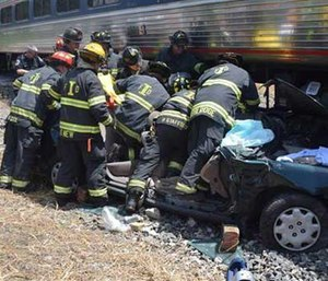 Emergency officials respond after a train and car crashed in Indianapolis. (AP Image)