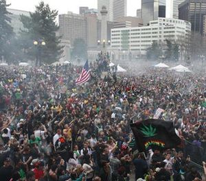 In this April 20, 2013 file photo, members of a crowd numbering tens of thousands smoke marijuana at the Denver 4/20 pro-marijuana rally at Civic Center Park in Denver. Denver police have said they would potentially use social media tracking software like Geofeedia to monitor the annual gathering. (AP File Photo/Brennan Linsley)
