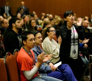 In this Nov. 19. 2014 file photo Yvette Felarca, an alumni of the University of California Berkeley and member of the group By Any Means Necessary, claps and yells as a vote is taken to raise tuition during a meeting of the University of California Board of Regents in San Francisco. (AP Photo/Eric Risberg, File)