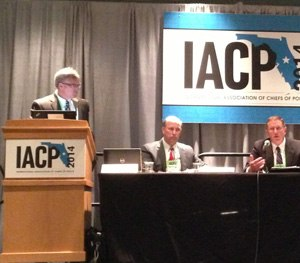 At the podium, Captain Paul O'Keefe of Aurora, Colo., is joined by Chief Michael Kehoe of Newtown, Conn., and Chief Ronnie Bastin of Lexington, Ky. during a session at IACP. (Photo courtesy American Military University)