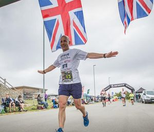 Firefighter Steve Holder crossing the finish line at one of his marathons. (Photo/Facebook)