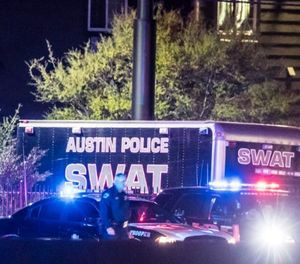 The scene outside a Round Rock-area hotel where authorities say the suspect in a string of Austin bombings has died on March 21, 2018. (Ricardo B. Braziell/Austin American Stateman/TNS)