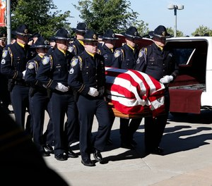 The flag draped casket of Sacramento Police Officer Tara O'Sullivan is carried into the Bayside Adventure Church for memorial services in Roseville, Calif., Thursday, June 27, 2019. (AP Photo/Rich Pedroncelli)