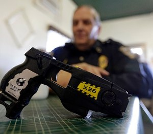 In this Nov. 14, 2013 photo, a Taser X26 is shown. (AP Photo/Michael Conroy)