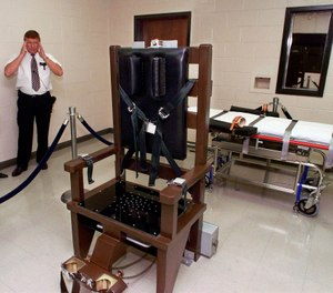 FILE - In this Oct. 13, 1999, file photo, Ricky Bell, the warden at Riverbend Maximum Security Institution in Nashville, Tenn., gives a tour of the prison's execution chamber. If Tennessee electrocutes Zagorski, it will be in an electric chair built by a self-taught execution expert who is no longer welcome in the prison system. (AP Photo/Mark Humphrey, File)