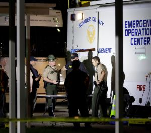 Law enforcement officials work at a command center set up at North Sumner Elementary School Saturday, April 27, 2019, in Bethpage, Tenn. (AP Photo/Mark Humphrey)
