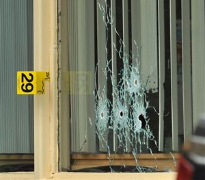 Bullet holes show in a window of a Days Inn Hotel office from a shooting early Thursday morning, July 7, 2016. (Andre Teague/Bristol Herald Courier via AP)