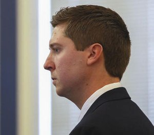 Ray Tensing reviews his body camera video of a stop previous to the Sam DuBose stop on the fifth day of his trial, Tuesday, Nov. 8, 2016, in Cincinnati. (Cara Owsley/The Cincinnati Enquirer via AP, Pool)