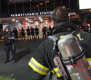A firefighters enters Pennsylvania Station during an emergency preparedness drill conducted by the NYC Office of Emergency Management (OEM), Sunday, Aug. 26, 2007, in New York. The multi-agency drill tested the effectiveness of emergency operations plans when responding to a terrorist incident within a train station. (AP Photo/ Louis Lanzano)