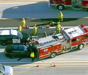 A still frame from video provided by KCBS-TV shows a Tesla Model S electric car that has crashed into a fire engine on Interstate 405 in Culver City, Calif. (KCBS-TV via AP)