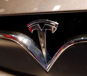 This Oct. 3, 2018, file photo shows a Tesla emblem at the Auto show in Paris. (AP Photo/Christophe Ena, File)