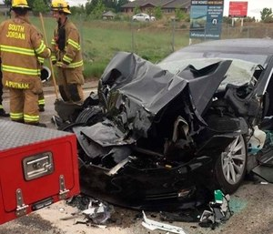 The Tesla Model S crashed into the truck at 60 mph apparently without braking before impact, according to police. (Photo/AP)