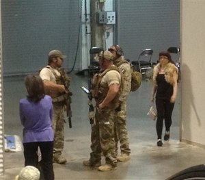 Members of the Garland Police Department stand inside the Curtis Culwell Center, Sunday, May 3, 2015, in Garland, Texas. (AP Image)