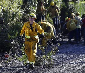 A firefighter cleans debris from an area damaged by storms in Montecito, Calif., Thursday. (Photo/AP)
