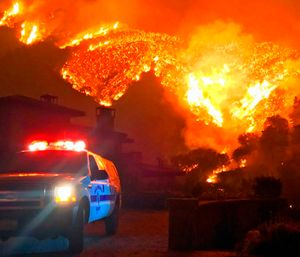 At 427 square miles, it is the largest fire in California's modern history, destroying 1,063 structures. (Photo/AP)