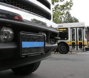 "The ""thin blue line"" emblem is shown on the front license plate of a truck Thursday, July 5, 2007, in Cambridge, Mass. (AP Image)"