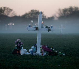 In this Feb. 17, 2018, file photo, an early morning fog rises where 17 memorial crosses were placed, for the 17 deceased students and faculty from the shooting at Marjory Stoneman Douglas High School in Parkland, Fla. (AP Photo/Gerald Herbert, File)