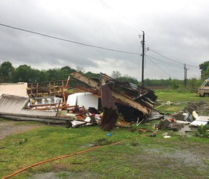 The remains of a trailer lie where a woman and her 3-year-old daughter were killed during a severe storm. (Maj. Ginny Higgins/St. Martin Parish Sheriff's Office via AP)