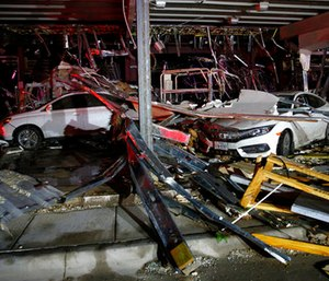 Cars and trucks are damaged as the walls blew out of the I-20 Dodge dealership after a tornado hit near Canton, Texas, Saturday, April 29, 2017. (Tom Fox/The Dallas Morning News via AP)