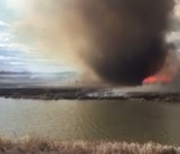 Watch: Firefighter jumps into lake to escape 'fire tornado'