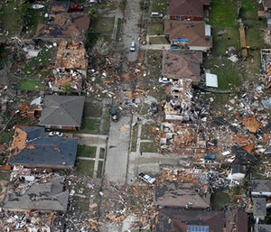 Destroyed and damaged homes are seen in this aerial photo after a tornado tore through the eastern neighborhood in New Orleans. (AP Photo/Gerald Herbert)