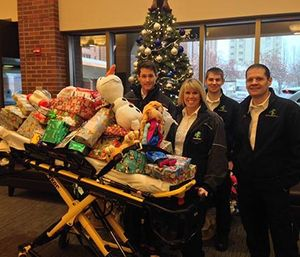 Ada County Paramedics stand with a toy-filled gurney for children hospitalized over the holidays. (Photo courtesy of Ada County Paramedics)