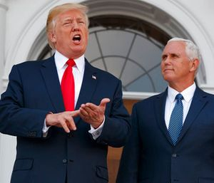 President Donald Trump, accompanied by Vice President Mike Pence, speaks to reporters before a security briefing at Trump National Golf Club in Bedminster, N.J. (AP Photo/Evan Vucci)