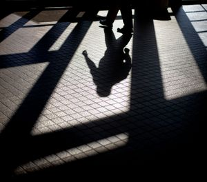 In this Friday, Dec. 7, 2012 photo, the shadow of a Georgia Department of Juvenile Justice correctional officer is cast as he leaves a training facility in Forsyth, Ga. (AP Photo/David Goldman)