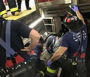 A woman trapped between an MBTA train and the platform at Central Square station in Cambridge was rescued. (Photo/Cambridge Fire Dept.)