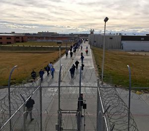 In this Jan. 30, 2018 file photo, inmates walk across the grounds of the Idaho State Correctional Institution in Kuna, Idaho. (AP Photo/Rebecca Boone, File)