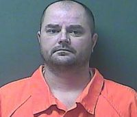 Paramedic charged after 2 die in vehicle crash