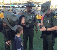 Photo: W.Va. boy asks troopers for autograph