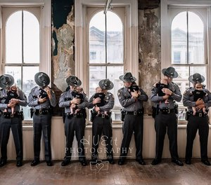 Each of the babies wore a specially-made onesie and their dads wore their Kentucky State Police uniforms. (Photo/Hueit Photography by Vicky Lea)