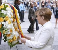 Police present flag to German Chancellor at 9/11 memorial