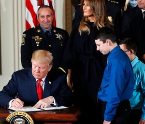 President Donald Trump signs a presidential memorandum declaring the opioid crisis a public health emergency in the East Room of the White House. (AP Photo/Pablo Martinez Monsivais)
