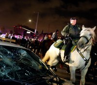 Video: Police car smashed, 17 arrested outside Calif. Trump rally
