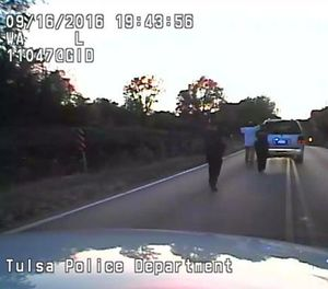 In this image made from a Friday, Sept. 16, 2016 police video, Terence Crutcher, center, is pursued by police officers as he walk to an SUV in Tulsa, Okla. (Tulsa Police Department via AP)