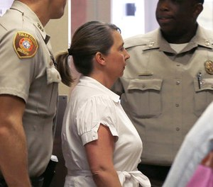Tulsa police officer Betty Shelby is led from the Tulsa County Sheriff's office into a courtroom in the Tulsa County courthouse, in Tulsa, Okla., Friday, Sept. 30, 2016. (AP Photo/Sue Ogrocki)