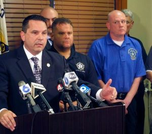 Jason Pappas, left, president of the Fraternal Order of Police Capital City Lodge No. 9, explains a no-confidence vote taken by Columbus officers against the city's mayor, city council president and safety-service director, at a news conference attended by several other union officials, on Friday, Aug. 11, 2017, in Columbus, Ohio. (AP Photo/Andrew Welsh-Huggins)