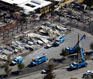 Pacific Gas & Electric crews work on restoring power lines in a fire ravaged neighborhood in an aerial view in the aftermath of a wildfire in Santa Rosa, Calif. (AP Photo/Marcio Jose Sanchez)